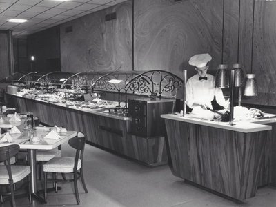 """One of the first """"sneeze guards"""" appeared in Johnny Garneau's American Style Smorgasbord in Monroeville 1958."""