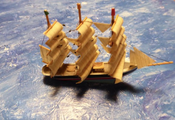A model sail-boat on painted paper thumbnail