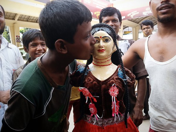 a teenage boy kissing a ribbon sellers mannequin just to show off.   Device Samsung S3. thumbnail