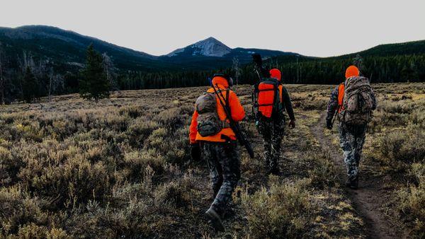 Three elk hunters in the Rockies thumbnail