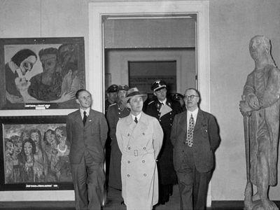 Joseph Goebbels viewing the 1937 Degenerate Art Exhibition.