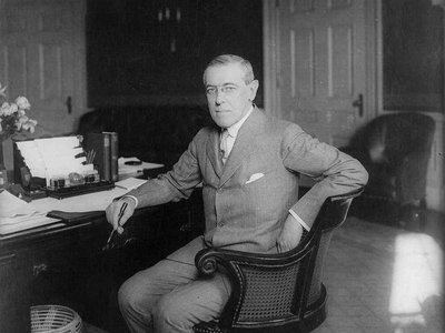 Woodrow Wilson at his desk in the Oval Office c. 1913.