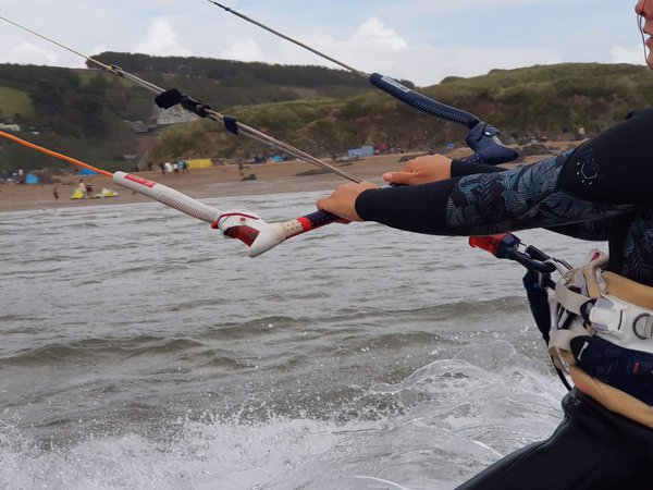 A kitesurfer with the view of the beach in the background thumbnail