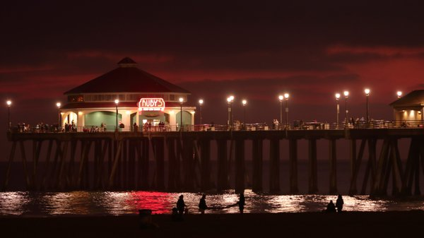 People packing up under the pier lights thumbnail