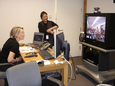 Volunteer Helen Dickerson (L) and staff member Colleen Brown (R) connected with students for virtual lessons from 2004-2011; Photo by SAAM staff.
