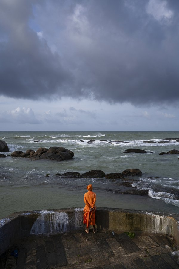 A sadhu watching the sea. thumbnail