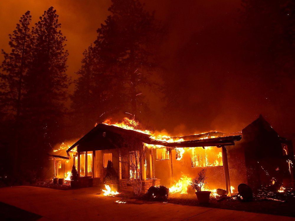 Wildfire engulfs house in California