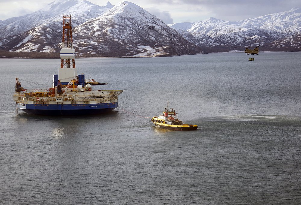 A Chinook helicopter caries supplies to the stranded Kulluk oil drilling platform in January.