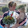 Susan Williams smiles at her daughter, Sydney, after she receives the bronze medal during ceremonies for the women's triathlon at the 2004 Summer Olympics in Athens.