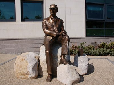 A statue of Frank Pantridge outside the Lisburn Civic Centre in Northern Ireland. His defibrillator sits beside him.