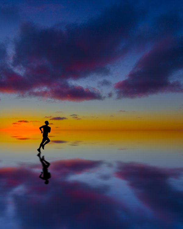 Running man with beautiful sky and reflection thumbnail