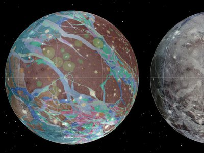 Streaked across Ganymede's surface are bright light-colored regions of ridges and grooves that overlap darker-colored terrains along the icy shell. The textured scar-like areas suggest that the moon's surface underwent extreme geologic changes over time.