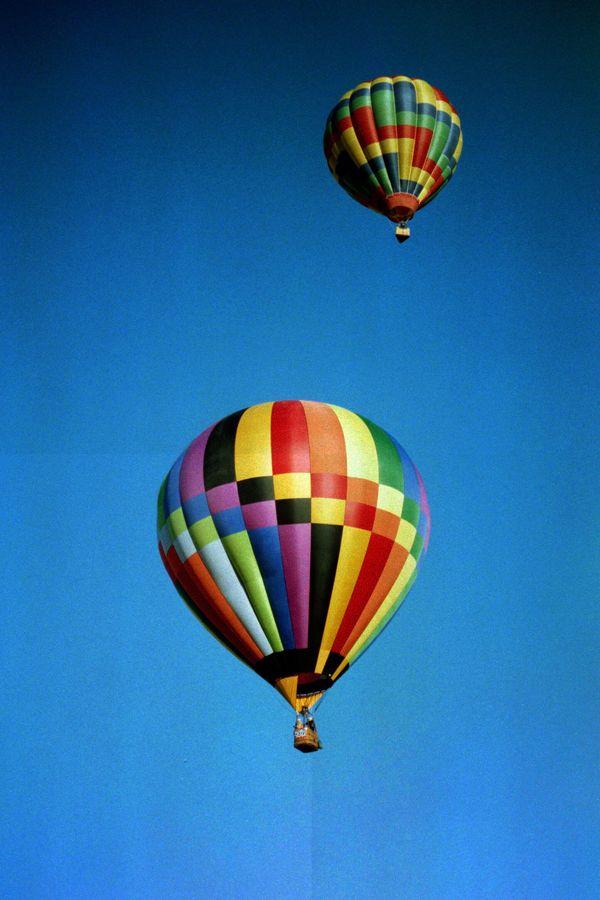 Two hot air balloons at the annual Albuquerque Balloon Festival. thumbnail