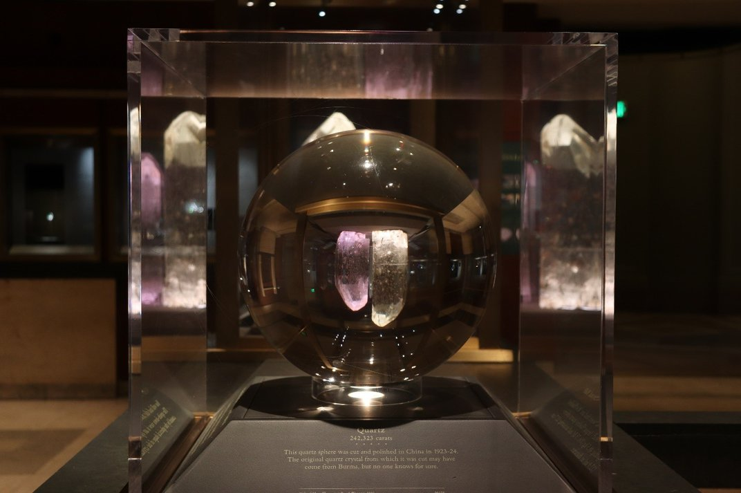 A large piece of clear quartz cut into the shape of a ball on display at the Smithsonian's National Museum of Natural History.