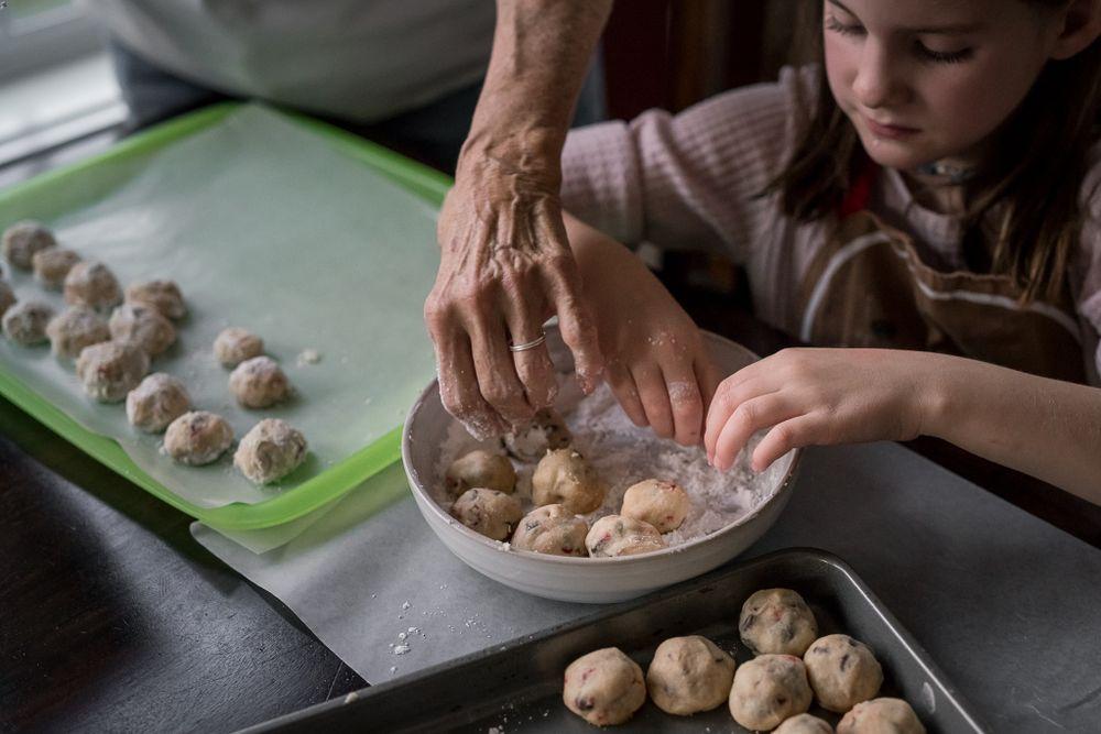 Nana makes Christmas treats with her granddaughter.