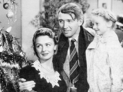 'It's a Wonderful Life' protagonist George Bailey with his family, Mary Hatch Bailey and Little Mary Hatch, at the end of the film.