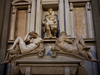 The team used bacteria to clean the tomb of Giuliano di Lorenzo de' Medici, Duke of Nemours (pictured here). Allegorical sculptures of Night and Day flank the marble sarcophagus.