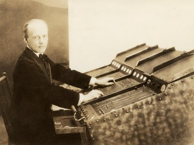 """Thomas Wilfred Sitting at the Clavilux """"Model E,"""" about 1924"""