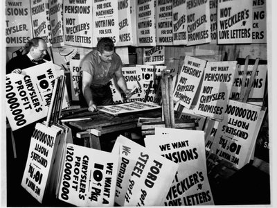 Signmakers Stanley Sawicki and Stanley Palka prepare several thousand picket signs in 1950 for a possible Chrysler auto workers' strike over employee pensions.