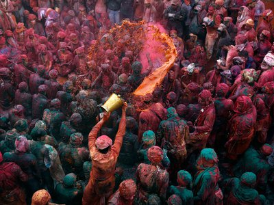 A man throws colored water as he celebrates Holi in Nandgaon, in the northern Indian state of Uttar Pradesh, February 28, 2015.