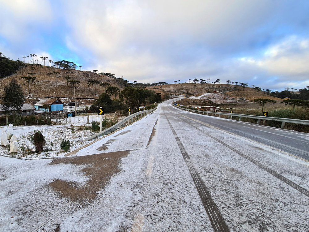 A image of a road leading to Sao Joaquim, Brazil. The road is covered with a thin dust of snow.