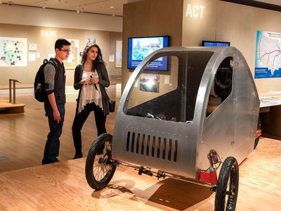 Cars are a liability and expensive to maintain for most Americans. The Future Cycles team builds human-powered vehicles that combine the efficiency of a bicycle or moped with the weather protection and carrying capacity of a car.