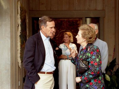 Thatcher visits with President Bush in Aspen, Colorado in 1990 during a diplomatic reception. News of her resignation lit up diplomatic channels around the world.