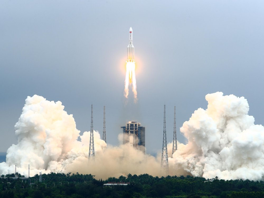 A photo of the first module of the Chinese Space Station blasting off on a rocket to space.