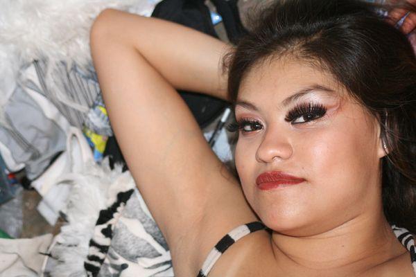 A dancing girl, lying down in the dressing-room at Circo Padilla, Mexico. thumbnail