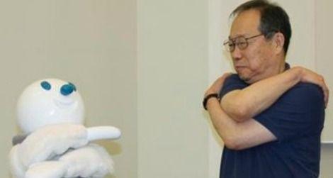 Taizo the robot gets seniors to exercise.