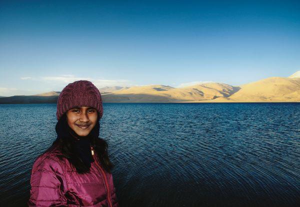My daughter posing before the Tso Moriri in the Changthag Plateau of Ladakh thumbnail