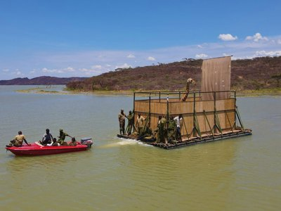 """The rescue team named their giraffe-carrying vessel the """"GiRaft."""""""