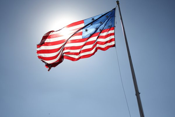 American Flag blowing in the wind thumbnail