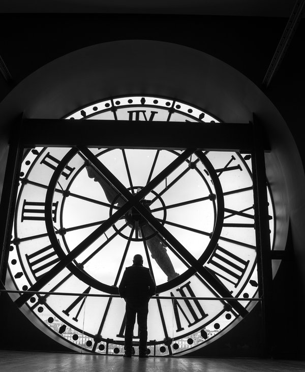 a person looking outside from window and clock at Musée d'Orsay thumbnail