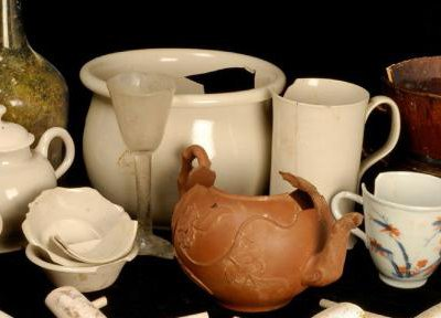 The finds from Clapham's Coffee House, some of which are pictured here, included teapots, wine glasses, and clay pipes.