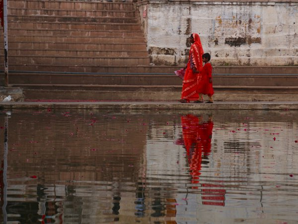 Woman and child walking along Sheetala Mata ghat at Pushkar Lake, India thumbnail
