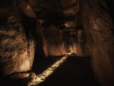 One of the interior passages of the 5,000-year-old Irish megalithic tomb of Newgrange. In this photo, sunlight enters the monument's main chamber at dawn on the winter solstice.