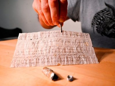 A couple hiking in the Alsace region of northeastern France spotted the tiny aluminum message capsule in a grassy field in September. The note, written in German in cursive script by a Prussian military officer, was probably attached to a carrier pigeon but never reached its destination.