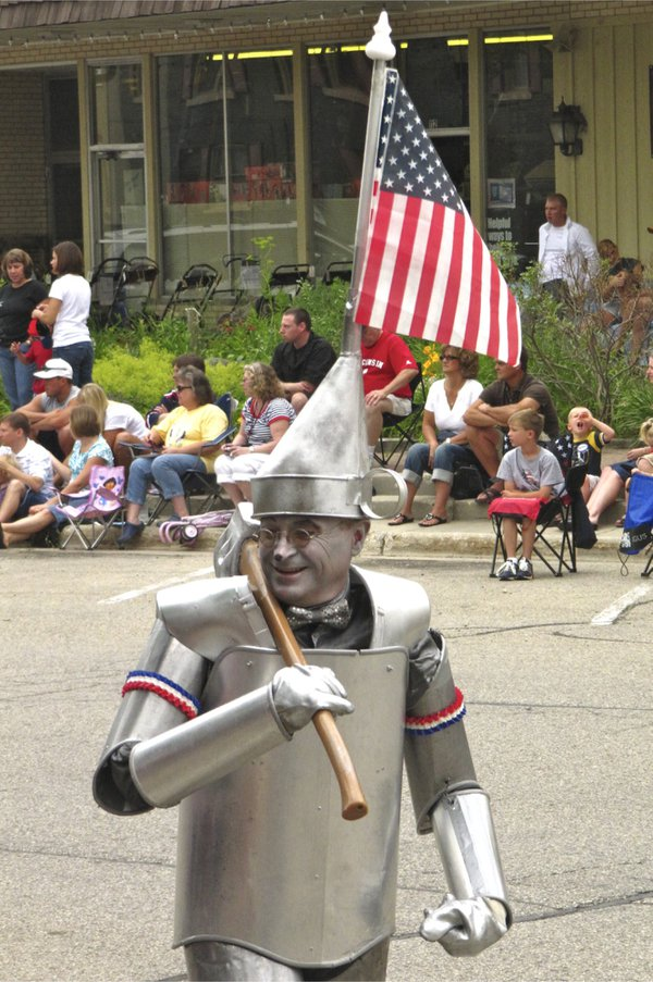Tin Man with flag in 4th of July parade thumbnail
