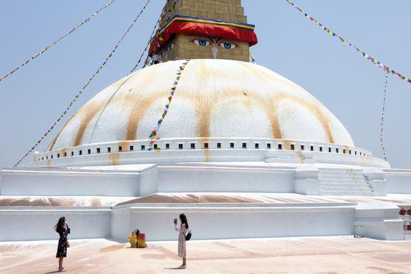 Tourists near the Boudhanath stupa thumbnail