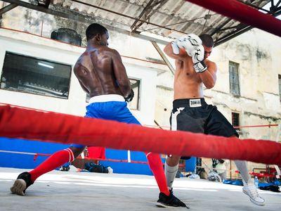 Two boxers spar in the ring in the outdoor gym Gimnasio de Boxeo Rafael Trejo in Old Havana, Cuba.