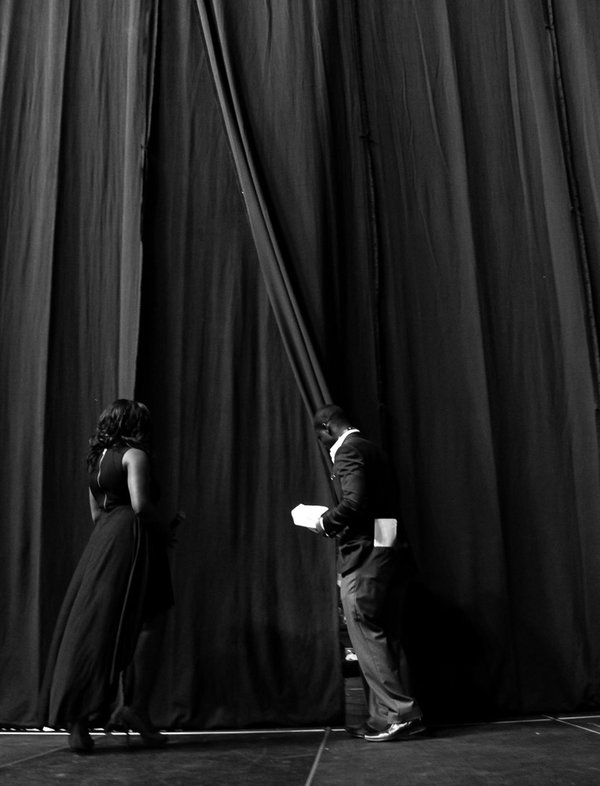 A young man holds the curtain for a young woman during the Florida Invitational Step Show, which is the largest student run step show in the Southeast. It is organized annually by the Black Student Un thumbnail