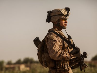 Col. Manuel Jimenez stands on patrol in Afghanistan