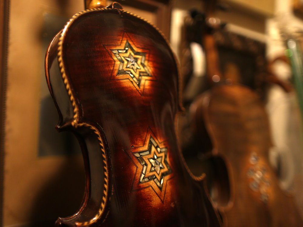 Star of David visible on back of violin