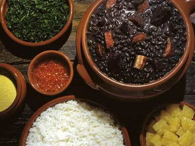 The colorful components of feijoada.
