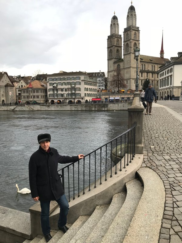 A Russian man posing in front of Grossmunster in Zurich thumbnail