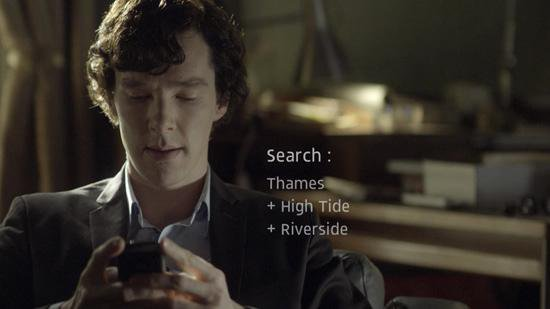 Benedict Cumberbatch as Sherlock Holmes searching for clues on his mobile phone