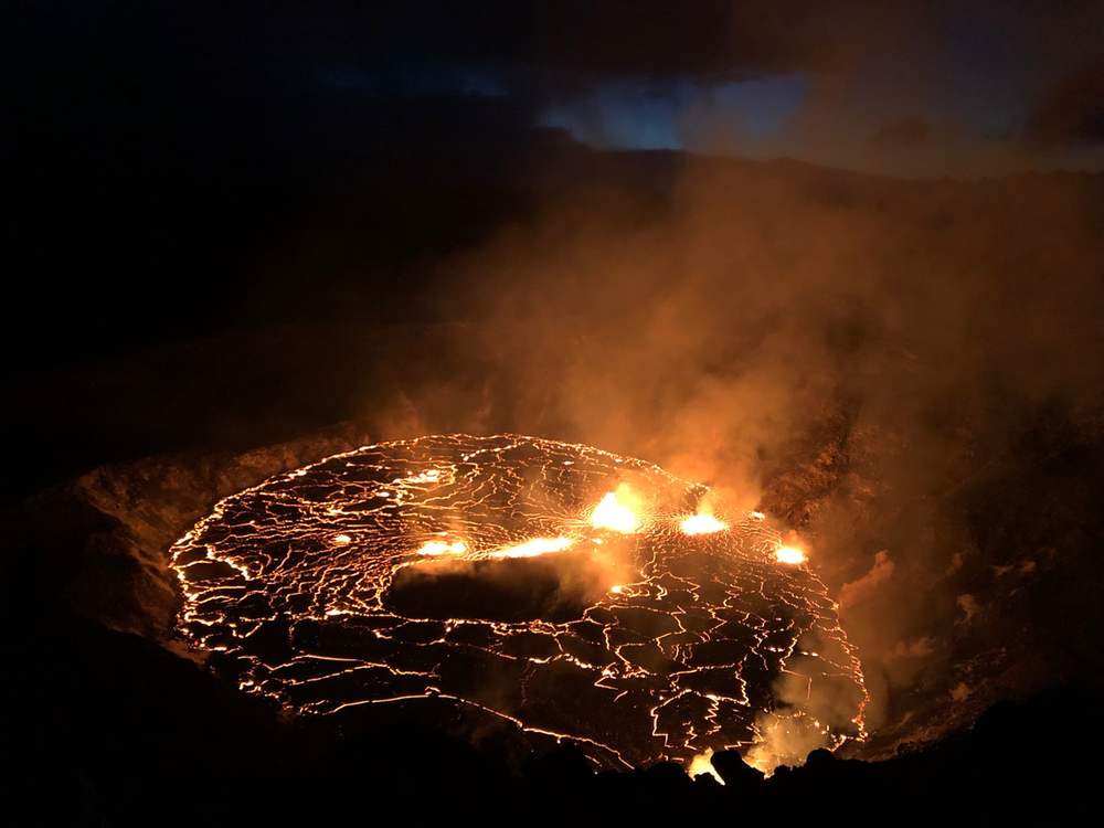 An image of the glowing red fissures inside of the Halema'uma'u Crater located on the Kīlauea volcano's summit