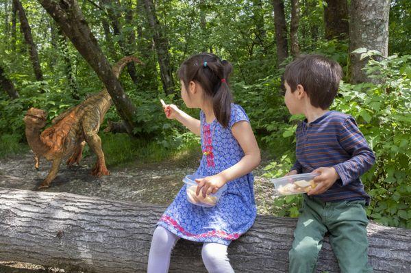 Sayva and Silas feeding a Chilesaurus. thumbnail