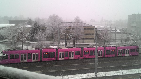 That pinky tram keep moving on a track while the snow is snowing extremely thumbnail